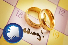 alaska map icon and wedding day plans, with gold wedding rings