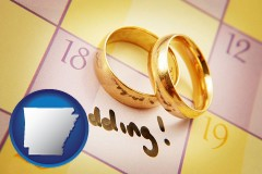 arkansas map icon and wedding day plans, with gold wedding rings