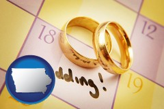 iowa map icon and wedding day plans, with gold wedding rings