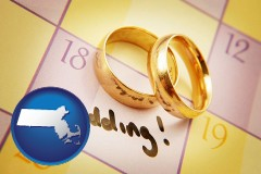 massachusetts map icon and wedding day plans, with gold wedding rings