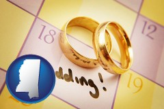 mississippi map icon and wedding day plans, with gold wedding rings