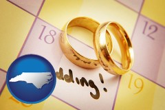 north-carolina map icon and wedding day plans, with gold wedding rings