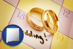 new-mexico map icon and wedding day plans, with gold wedding rings