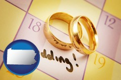 pennsylvania map icon and wedding day plans, with gold wedding rings