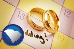 south-carolina map icon and wedding day plans, with gold wedding rings