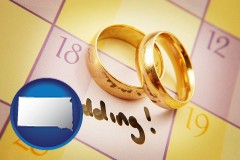 south-dakota map icon and wedding day plans, with gold wedding rings
