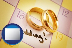 wyoming map icon and wedding day plans, with gold wedding rings