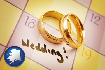 wedding day plans, with gold wedding rings - with Alaska icon