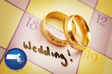 wedding day plans, with gold wedding rings - with Massachusetts icon