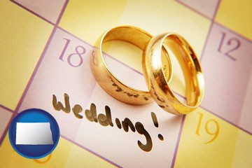 wedding day plans, with gold wedding rings - with North Dakota icon