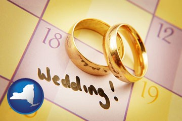 wedding day plans, with gold wedding rings - with New York icon