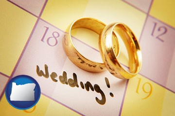 wedding day plans, with gold wedding rings - with Oregon icon