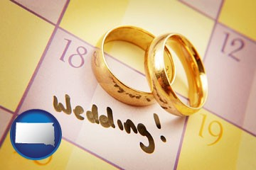 wedding day plans, with gold wedding rings - with South Dakota icon