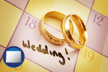 wedding day plans, with gold wedding rings - with Wyoming icon
